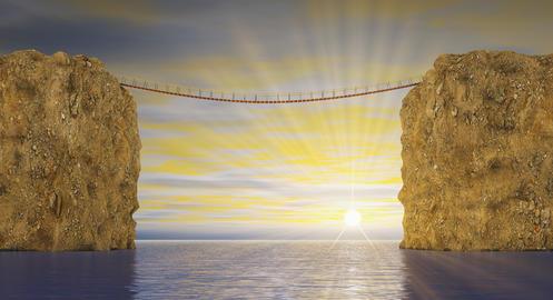 Suspension bridge on sea sunset Photo