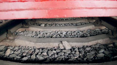 4k video of moving underneath old vintage steam locomotive on railroad station Live Action