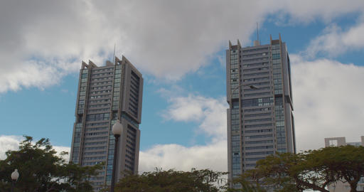 Time lapse. High twin buildings. Clouds in the sky in sunny day Live Action