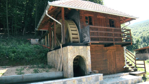 Preserved wooden watermill in the mountain Live Action