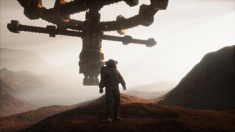 Astronaut walking on an Mars planet GIF