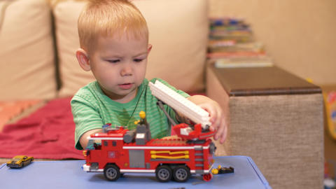 Boy playing with toy car Live Action