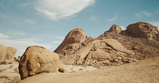 Colorful footage of the desert with big rocks in Namibia, blue sky, 4k Live Action