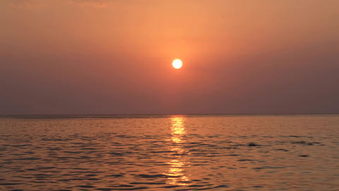Picturesque scenery of sunset on seashore Live Action