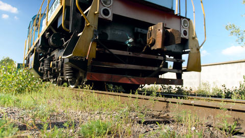 4k video of old diesel locomotive riding on abandoned railroad at big factory Live Action