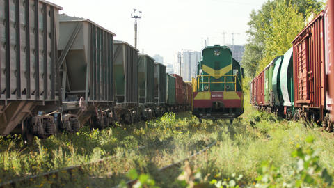 4k video of diesel locomotive riding between long cargo railway train. Concept Live Action