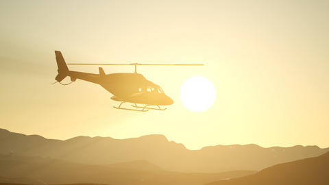 extreme slow motion flying helicopter and sunset sky Live Action