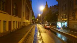 Rear view from train ride at night Helsinki, residential houses at Katajanokka Footage