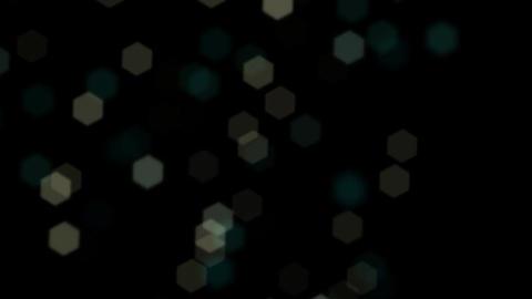 Flashing Lens Hexagon Bokeh Flying Around on a Black Background Footage