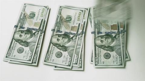 1080p Splitting Money Into Three Equal Stacks Footage