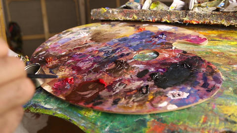 A palette with paints in an art workshop Footage