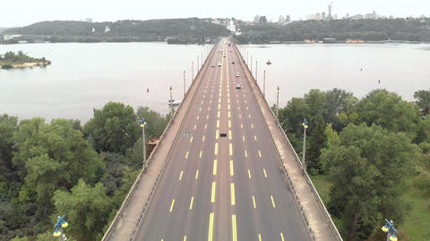 Paton Bridge across the Dnipro river in Kyiv, Ukraine. Aerial view Live Action