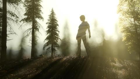 Young Woman standing alone outdoor with wild forest mountains Live Action
