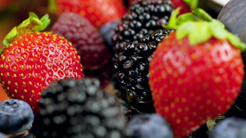 4k macro video of lots of fresh tasty berries lying on the table. Perfect Live Action