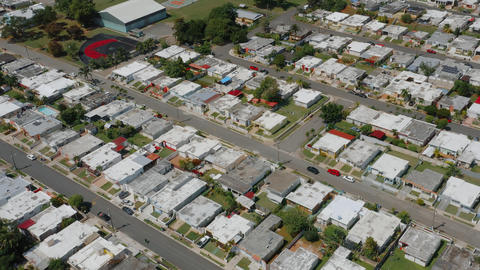 Aerial establishing shot of a residential area in Puerto Rico GIF