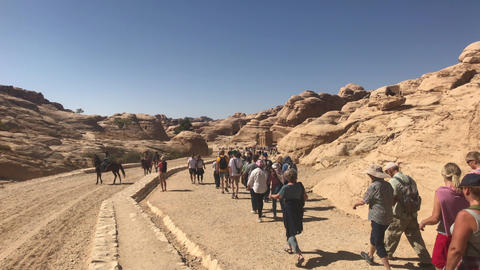 Petra, Jordan - October 17, 2019: tourists move on the road part 3 Live Action