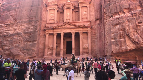 Petra, Jordan - October 17, 2019: tourists are photographed against the backdrop Live Action