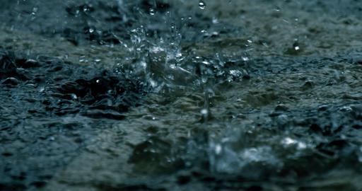 B-roll establishing shot of a hard rain falling at night GIF