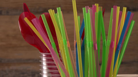 Everyday plastic waste, various plastic utensils, environmental protection on Live Action