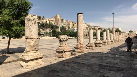 Amman, Jordan - October 20, 2019: Roman Amphitheater tourists walk through the Live Action