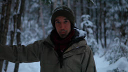 Smiling man standing alone in the snow for fun Live Action