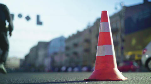 Police cone on the road. Place of accident. Transport. Road traffic. Sign. Kyiv Live Action