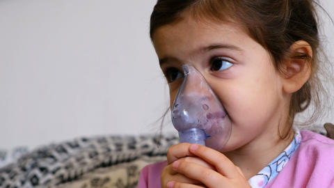 childhood asthma inhaling mask illnesses little baby girl with flu id doing Live Action