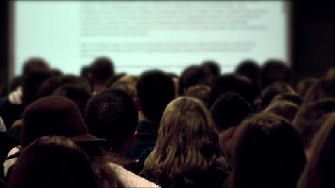 4K Uneven Students in Lecture Hall Listening to Presentation of The Footage