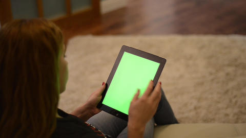 Woman using iPad above view Footage