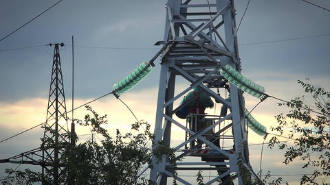Electrician repair man Pylons High Voltage Footage