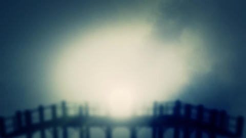 A creepy Wooden Pier through a misty cloudy fog in the morning Footage