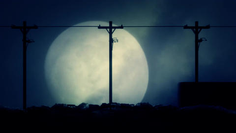 Cars Passing by on a Road at Night on a Spooky and Scary Rising Full Moon Backgr Footage