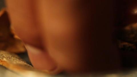 Fingers Picking Up Cinnamon Sticks Close Up Footage