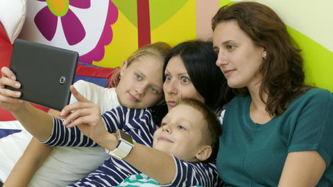 Two Mothers With Their Kids Making Funny Selfie Footage