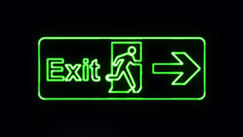 Green Neon Exit Sign Lighting Up Live Action