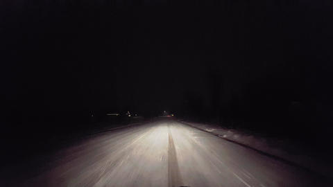 Driving While Snowing on Rural Road at Night. Driver…, Live Action
