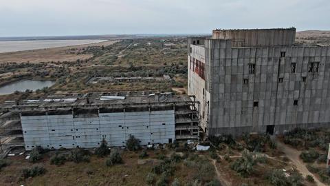 AERIAL SHOT CRIMEA near SHELKINO city AUGUST 2019 Old abandoned atomic power GIF