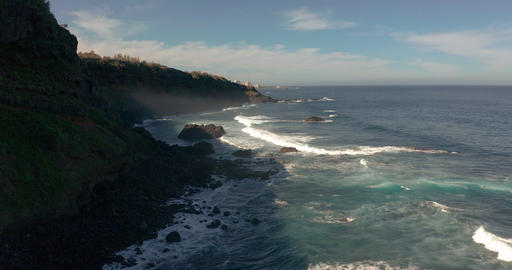 Aerial view. Wonderful endless ocean view with white waves breaking on black Live Action