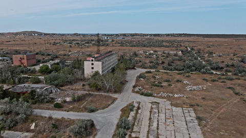 AERIAL SHOT CRIMEA near SHELKINO city AUGUST 2019 Old abandoned building whis GIF