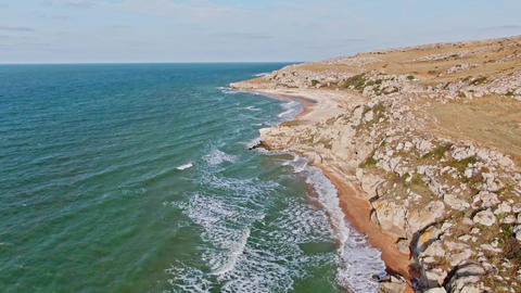Natural landscape from a bird's eye view The green blue sea with long foamy GIF