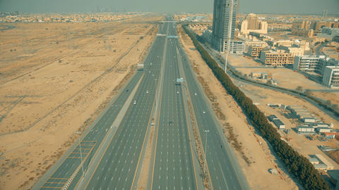 Aerial view of a wide straight highway in Dubai, UAE Live Action