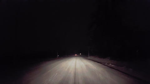Driving Behind Car Brake Lights While Snowing on Rural Road at Night. Driver Point of View POV Snow Live Action