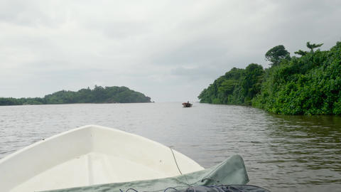 4k video of small motorboat sailing in the ocean from small river in tropical Live Action