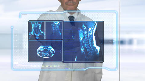 Doctor examining Virtual MRI Scans Live Action