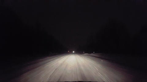 Driving in Snow Blizzard With Oncoming Vehicle Lights Approaching on Rural Road at Night. Driver Live Action