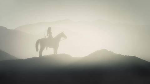 Female Warrior Sitting on a Horse in Mountains Live Action