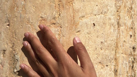 female hand touching acient ruins of old roman city, travel concept, history Live Action