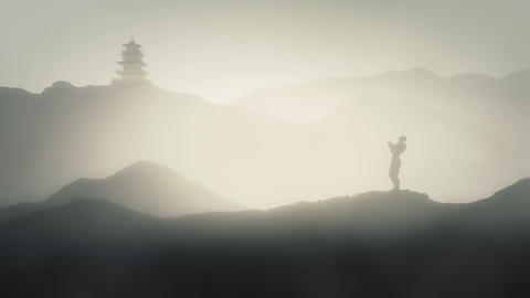 Person Meditating on the Mountains of Japan with Japanese Pagoda Live Action