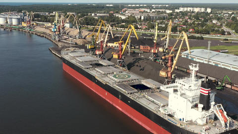 VENTSPILS, LATVIA - JULY, 2019: Aerial view of big dry cargo ship and port Live Action