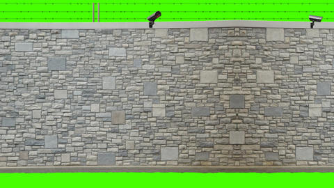 Wall with Barbed Wire and Security Camera on a Green Screen Background Footage